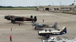 KA114 taxies in beside the Lancaster on arrival.