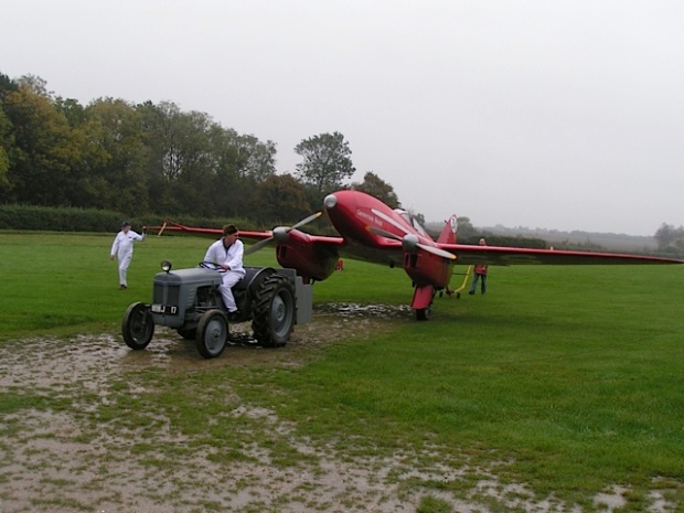 DH88 being towed at a muddy Old Warden 2004.