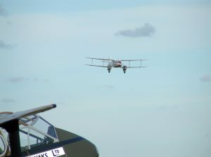 Dragon Rapide landing with another in the foreground.