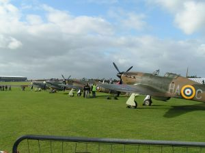 An Impressive line up of The Vacher, Hangar 11, Shuttleworth and Historic Aircraft Collection Hurricanes at North Weald.