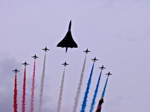 Concorde with the Red Arrows, overflying Buckingham Palace in 2002.