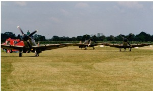 3 Spitfires taxy back in after filming for Piece Of Cake.