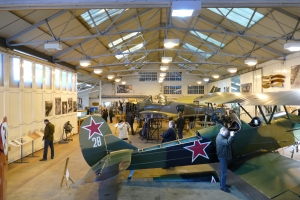 A wider look back across the hangar, showing the Polikarpov Po-2, Piston Provost and the Spitfire restoration.