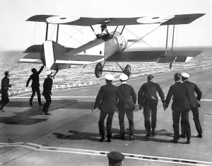 Dunning attempting a landing on HMS Furious on the 7th August. The crew can be seen trying to pull the aircraft down. Sadly this attempt was unsuccessful and Dunning was killed.