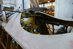 A look in the cockpit of Shuttleworth's replica triplane under restoration.
