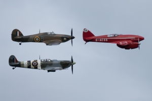 Dodge Bailey leads the BBMF pair past the Old Warden flight.