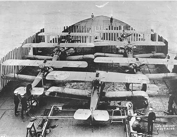 The 7 Camel's of the raid lined up on HMS Furious waiting for take off.