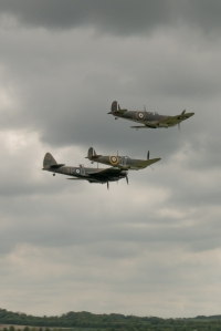 The Blenheim and Spitfires run in for a break to land.