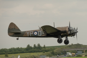 John Romain brings the Blenheim in to land over the M11.