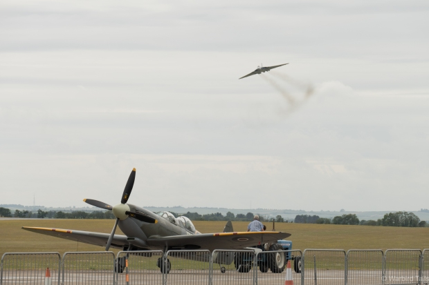 That classic smoke trail clearly evident as XH558 passes over another British Icon.