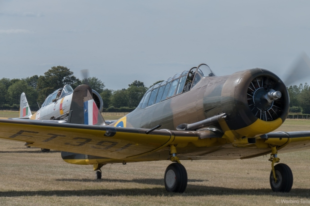 The pair of Harvards taxy back after their display.