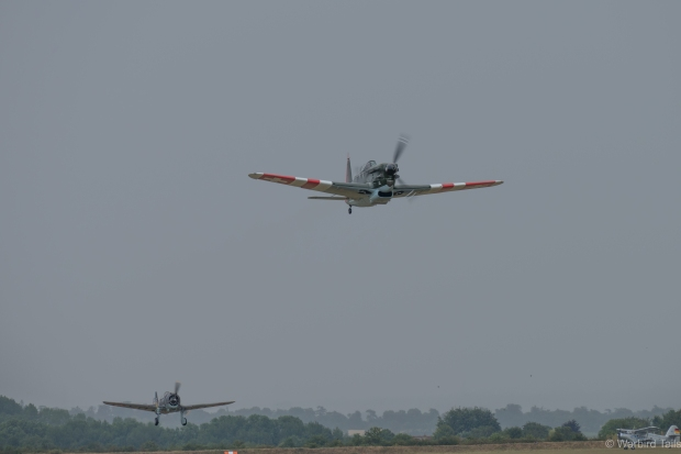 The Morane leads the Hawk 75 into the gloomy skies.