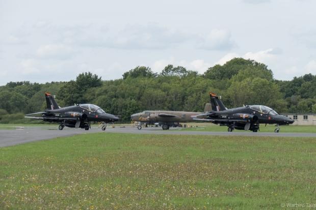 The Hawk pair taxy past the B25.