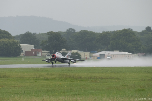 "The Mig getting airborne from the ""damp"" runway."