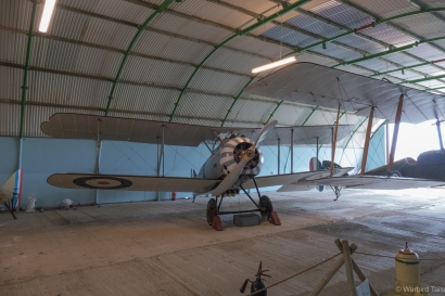 The recent arrival from New Zealand, the Sopwith Snipe, looks very at home in the hangar at Stow.