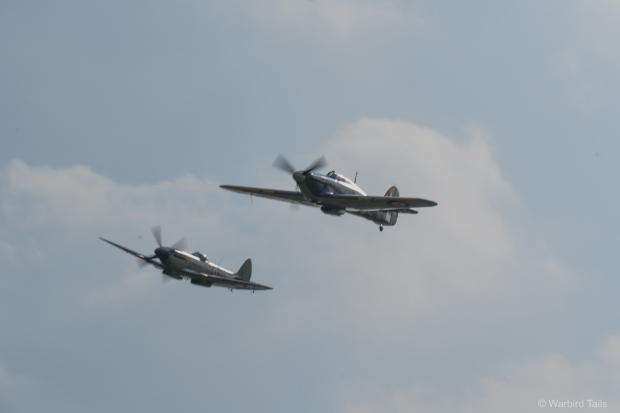 The Sea Hurricane and Seafire sweep over the field.