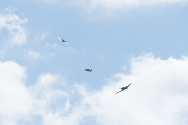 The Spitfire Mk I chases the two Buchons around the sky.