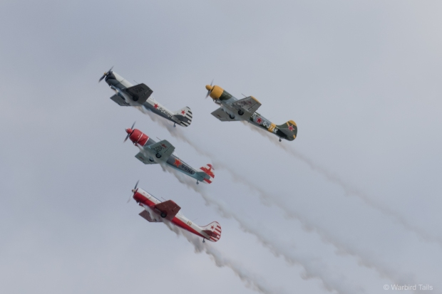 The Aerostars pulling up into a loop.