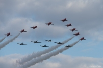 Smoke On: The BBMF fighters join the Red Arrows during Sunday's finale.